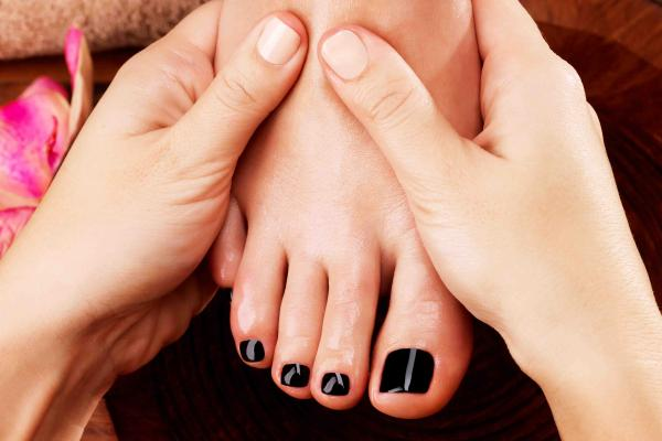 Pedicure with semi - permanent nail polish